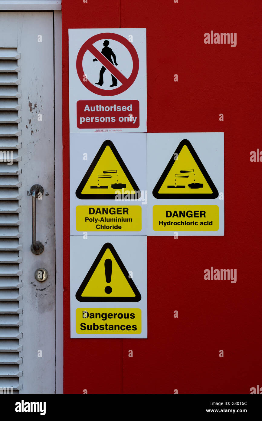 Hazardous chemicals warning signs at a leisure centre, UK - Stock Image