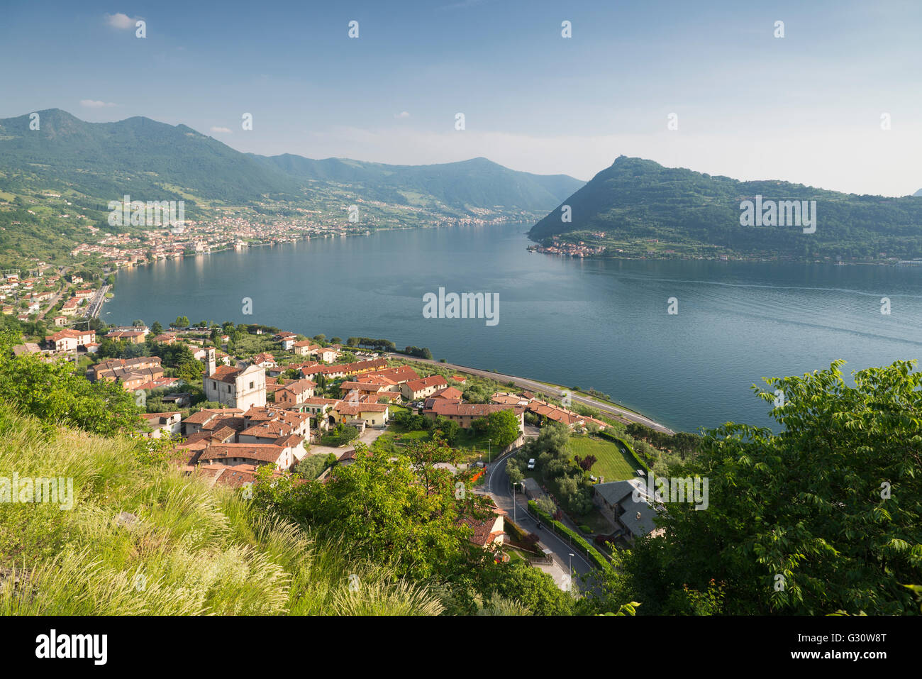Viewpoint at Saint Peter Church in Marone overlooking the panorama of Lake Iseo and Monte Isola island in afternoon - Stock Image