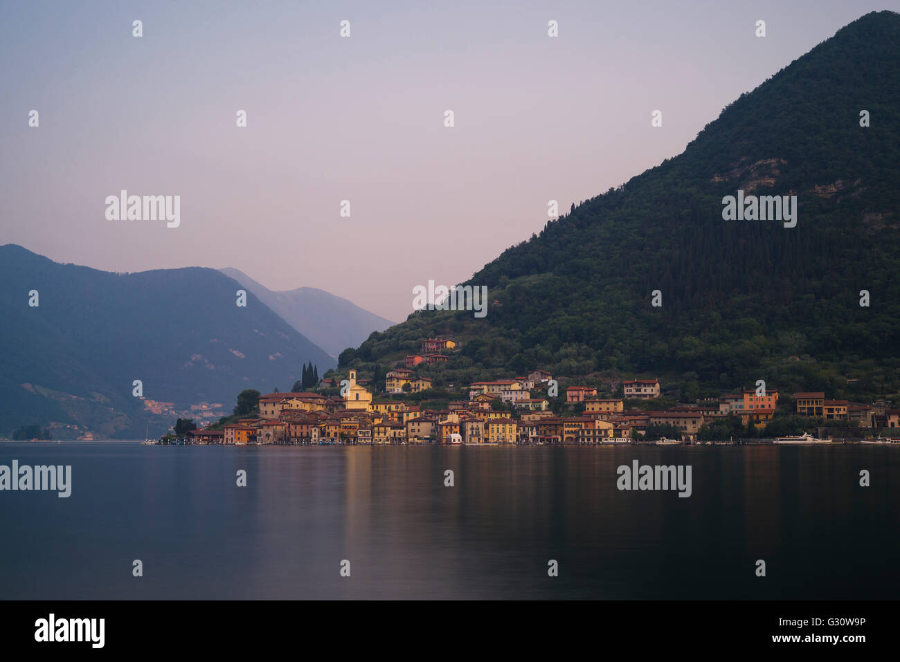 Picturesque mediterranean village of Peschiera Maraglio on the shore of Monte Isola island on Lake Iseo at dawn, - Stock Image