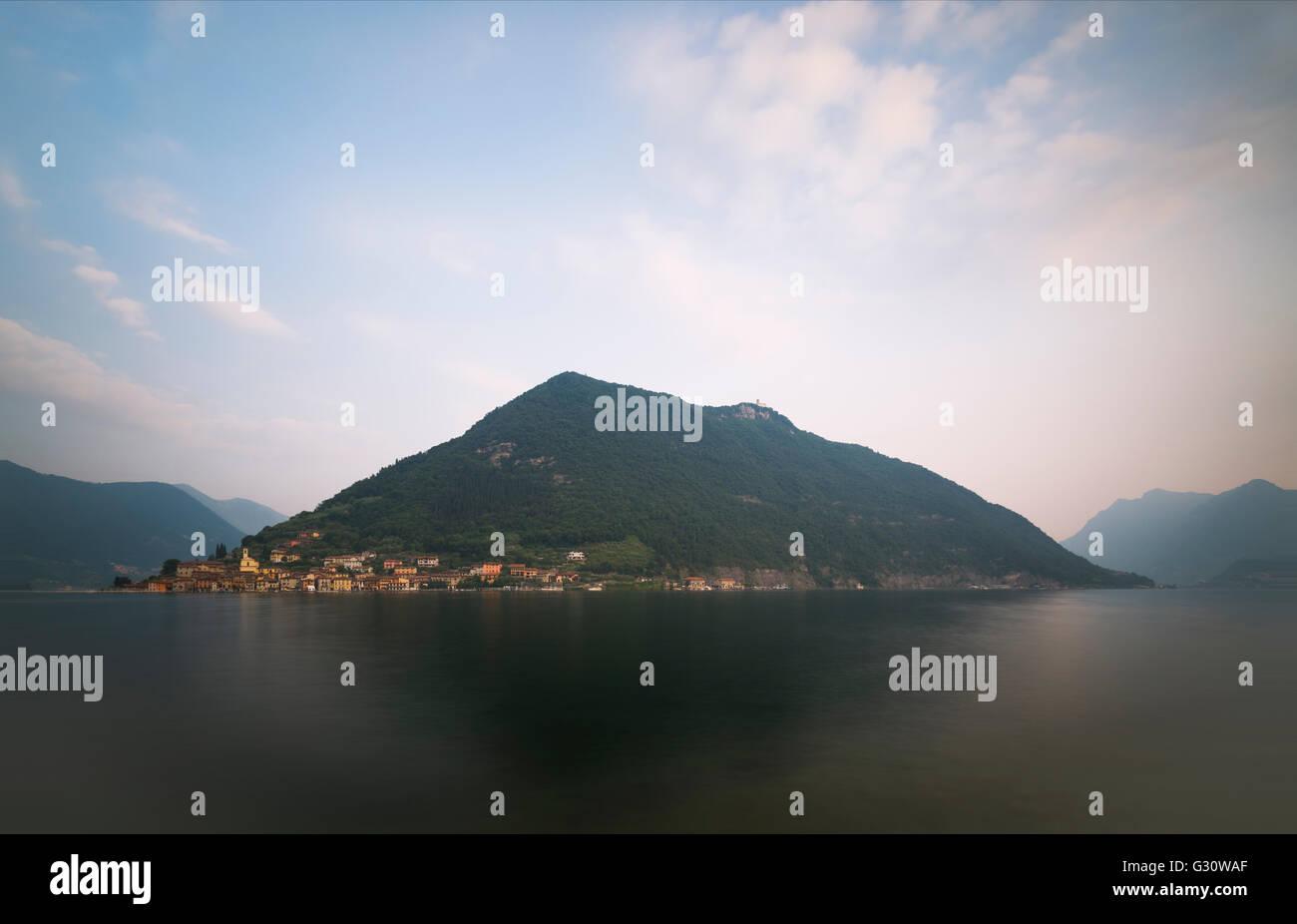 Panorama of scenery with Monte Isola island at Lake Iseo at sunrise,Sulzano,Lombardy,Italy - Stock Image