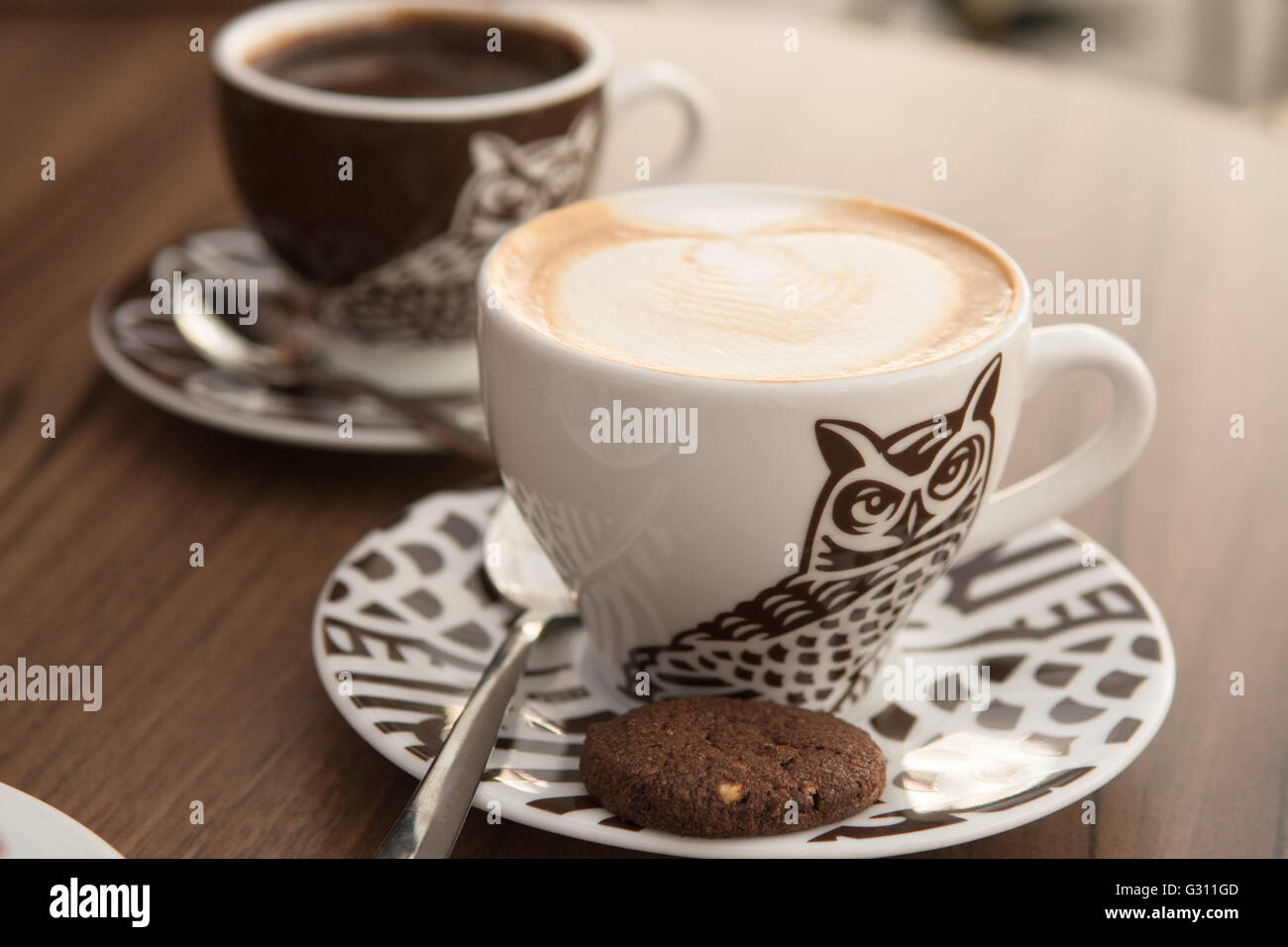 cappuccino and hot chocolate from Cukiernia Sowa coffee shop on Long Street in the heart of Gdansk, Poland Stock Photo