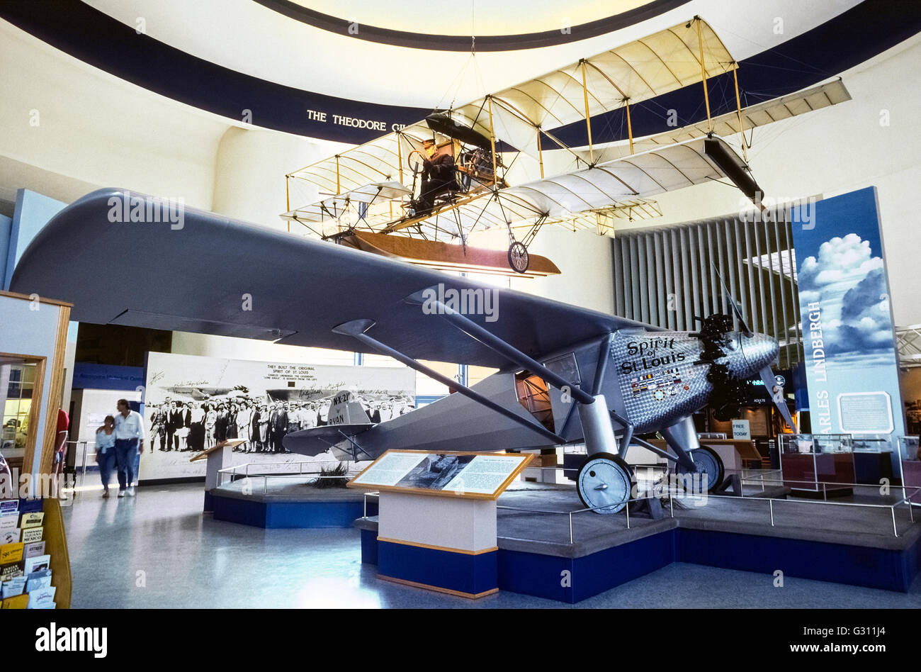 """A replica of the Charles A. Lindbergh's """"Spirit of St. Louis"""" airplane that was the first to fly nonstop from New York to Paris in 1927 is a major attraction at the San Diego Air & Space Museum in San Diego, California, USA. With financial backing from the Missouri city after which it was named, the monoplane was designed, built and tested in San Diego before making its historic flight that took 33-1/2 hours and won Lindbergh $25,000 in prize money. Displayed above the """"Spirit of St. Louis"""" is an early glider aircraft. Stock Photo"""
