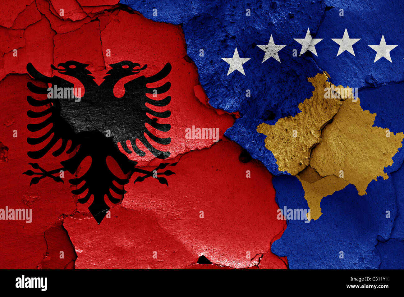 flags of Albania and Kosovo painted on cracked wall - Stock Image