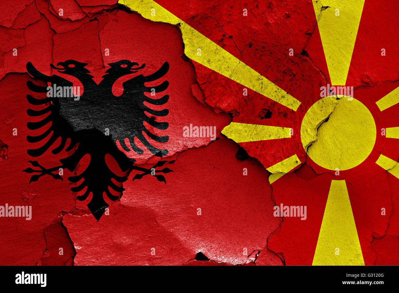 flags of Albania and Macedonia painted on cracked wall - Stock Image
