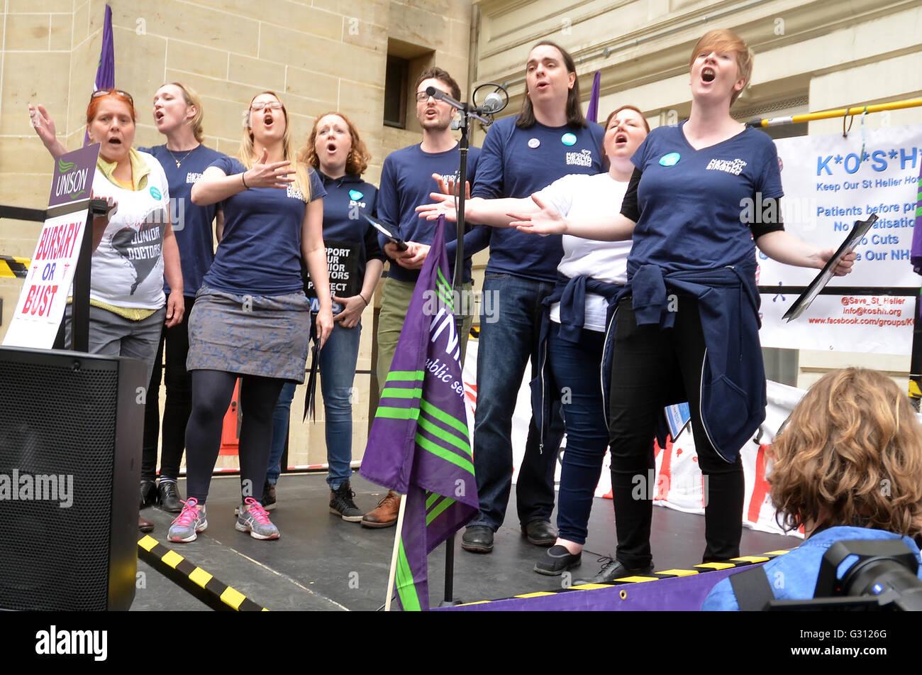Department Health,Whitehall,London,UK.NHS choir perform.Nurses protest outside Richmond House Department Health - Stock Image