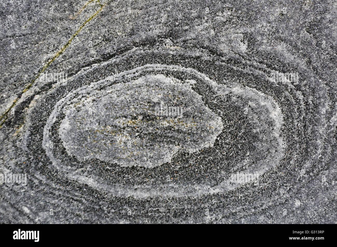 Rock circles on a stone on Taransay - Stock Image
