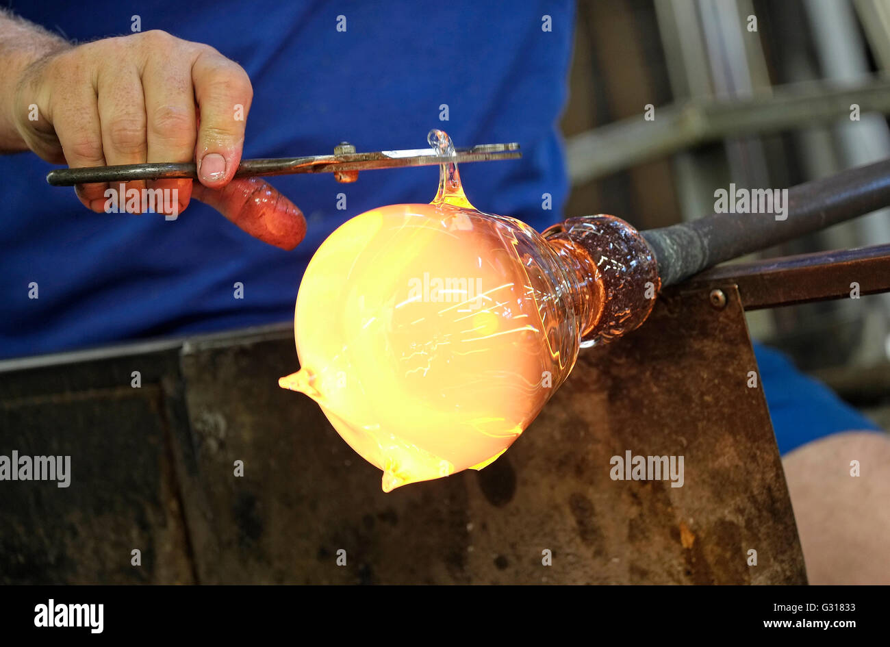 glass maker craftsman shaping ornament - Stock Image