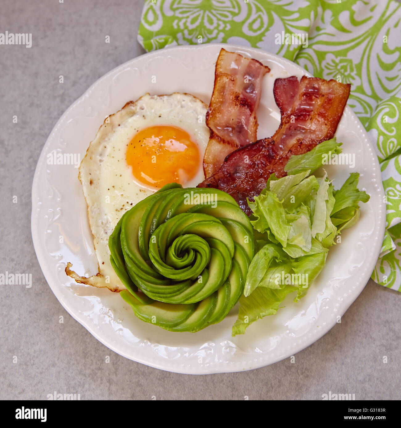 Fried Egg, Bacon and Avocado Rose for Breakfast - Stock Image
