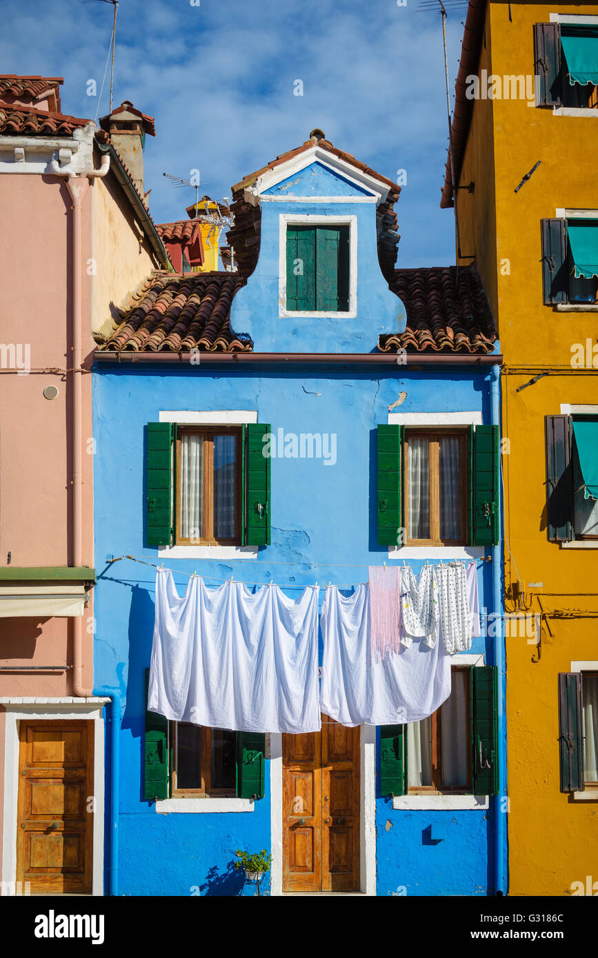 Hung laundry on the lines in front of houses in Burano. - Stock Image