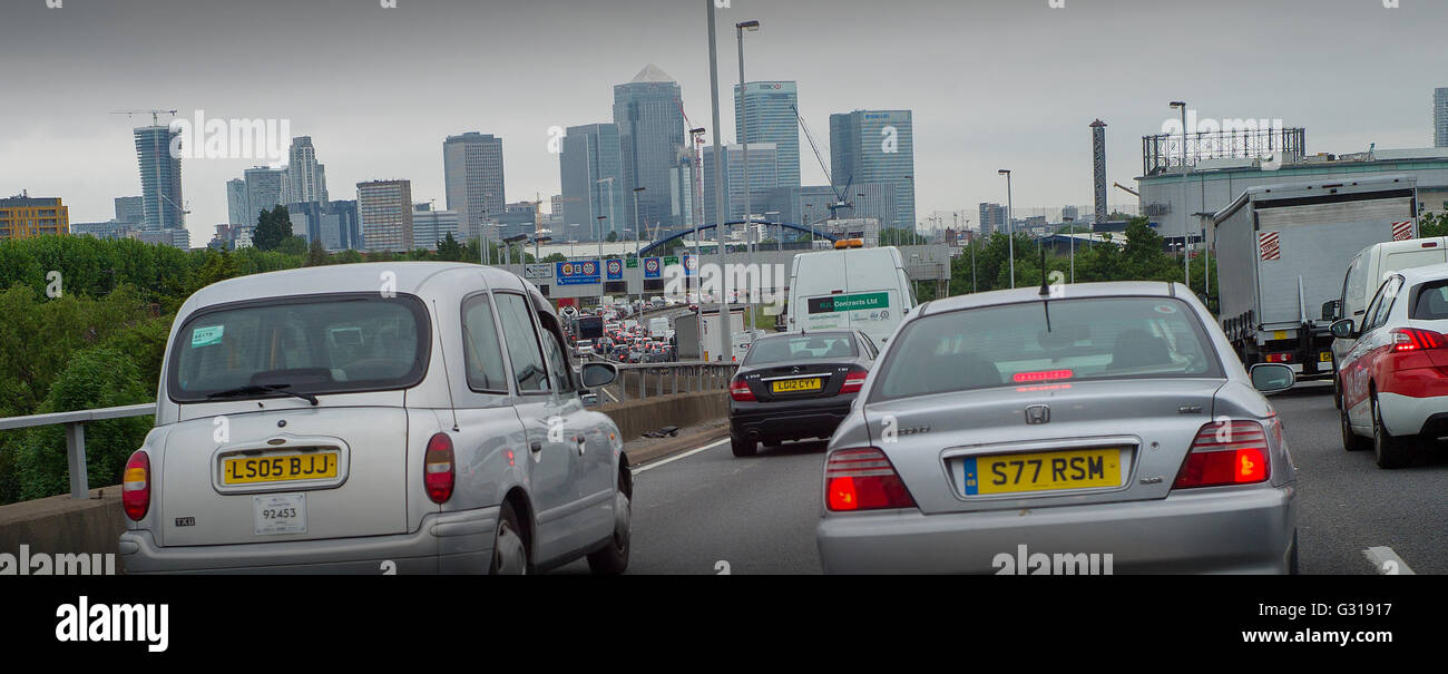 London England UK. Heavy traffic on the A2 road entering London towards Blackwall Tunnel showing Canary Wharf development Stock Photo