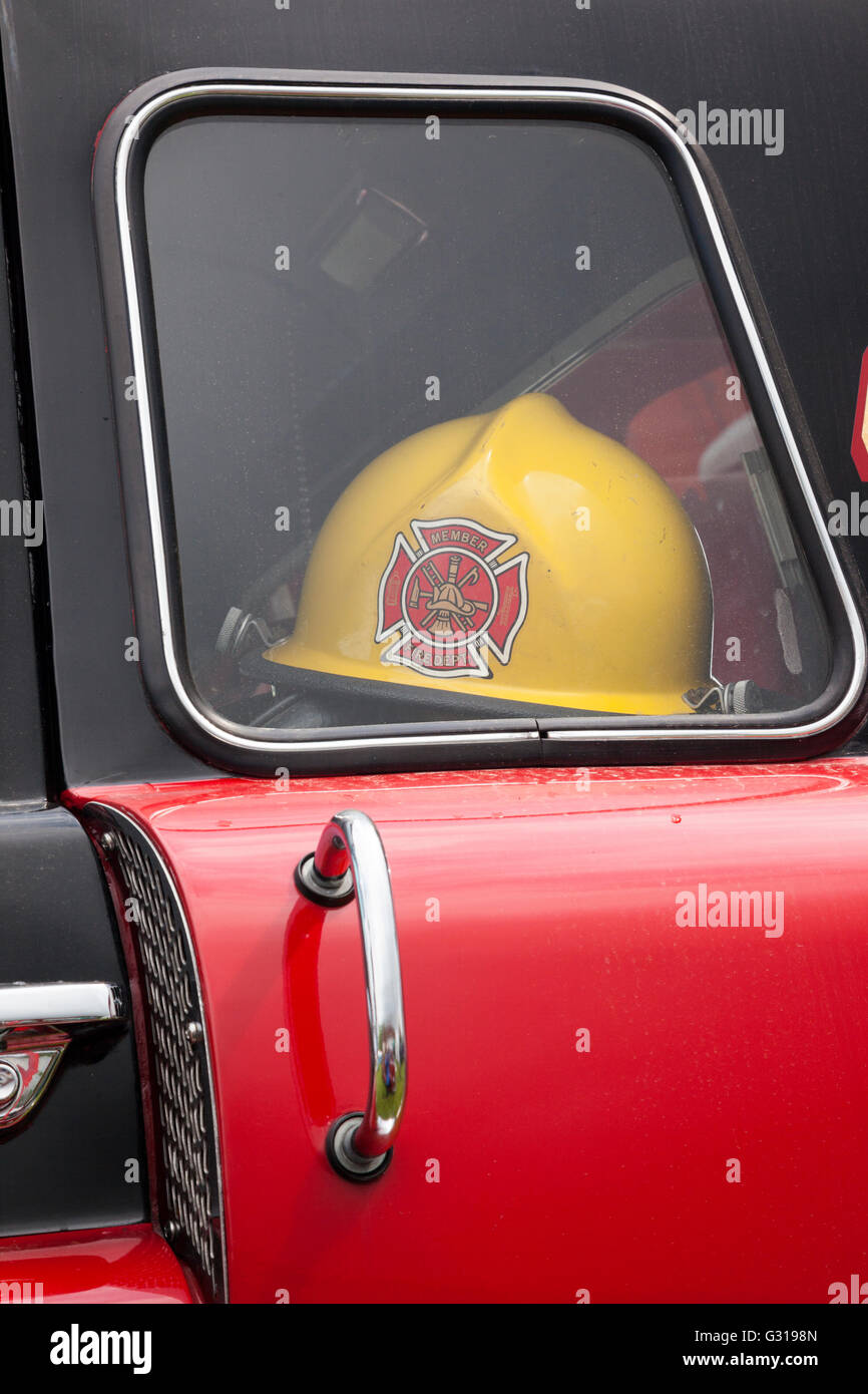 Vintage Fire Engines.on Display With Firefighters Helmet Shown Inside.    Stock Image