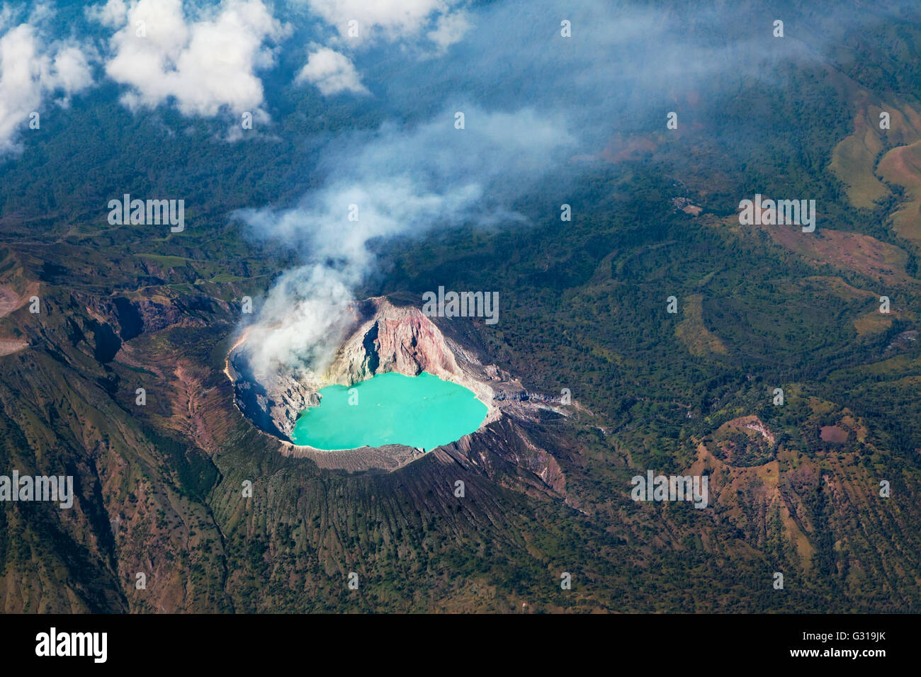 Aerial photo of active volcano Ijen in East Java - largest highly acidic crater lake in world with turquoise sulphuric - Stock Image