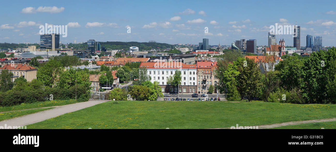 VILNIUS, LITHUANIA - MAY 12, 2016: Panorama of the spring sunny city and public garden from top of the old  Tauras mountain. Are Stock Photo