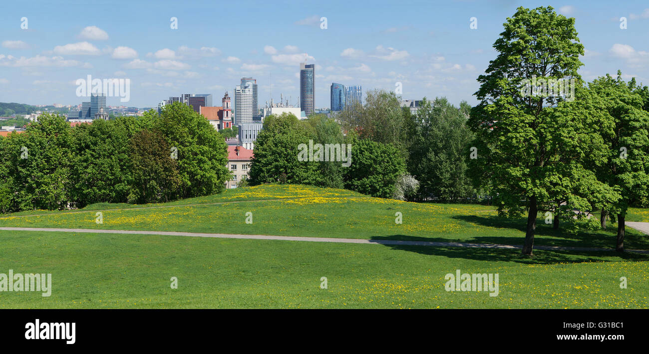VILNIUS, LITHUANIA - MAY 12, 2016: Panorama of the spring sunny public garden on top of the old historical Lithuanian Tauras mou Stock Photo