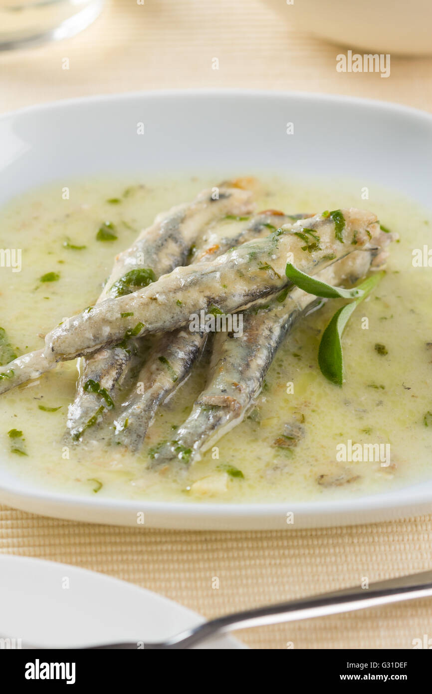 A plate of marinated anchovies - Stock Image