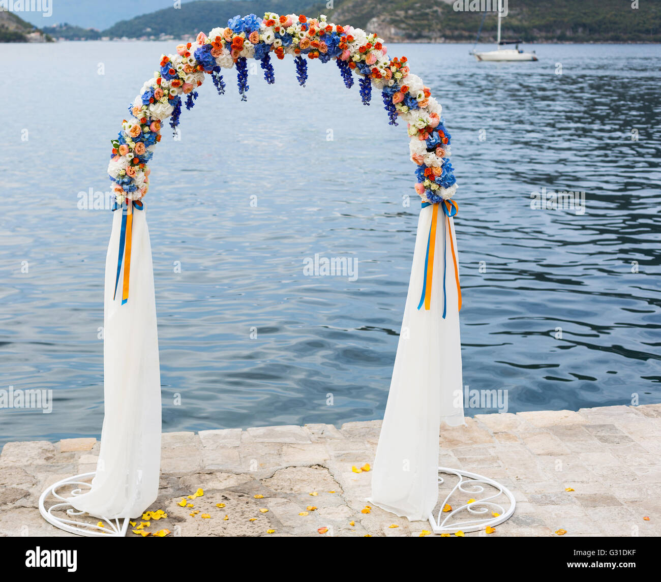 wedding arch decorated with flowers outdoors - Stock Image