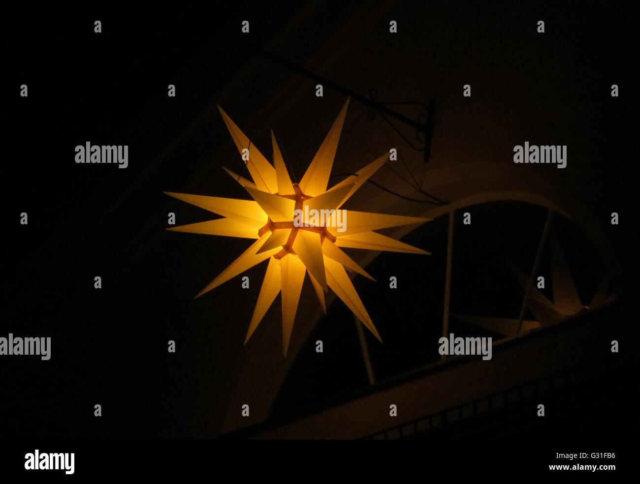 Berlin, Germany, brilliant Moravian Star at night - Stock Image