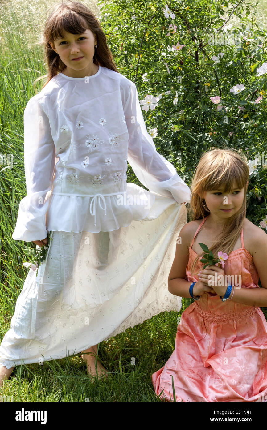 The age of innocence, 6- a 7-year-old girl in white dress, girls games Bride - Stock Image