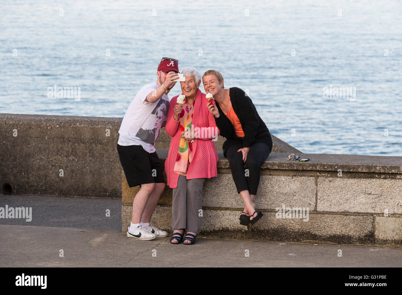 3 three people group selfie photo man men woman uk - Stock Image