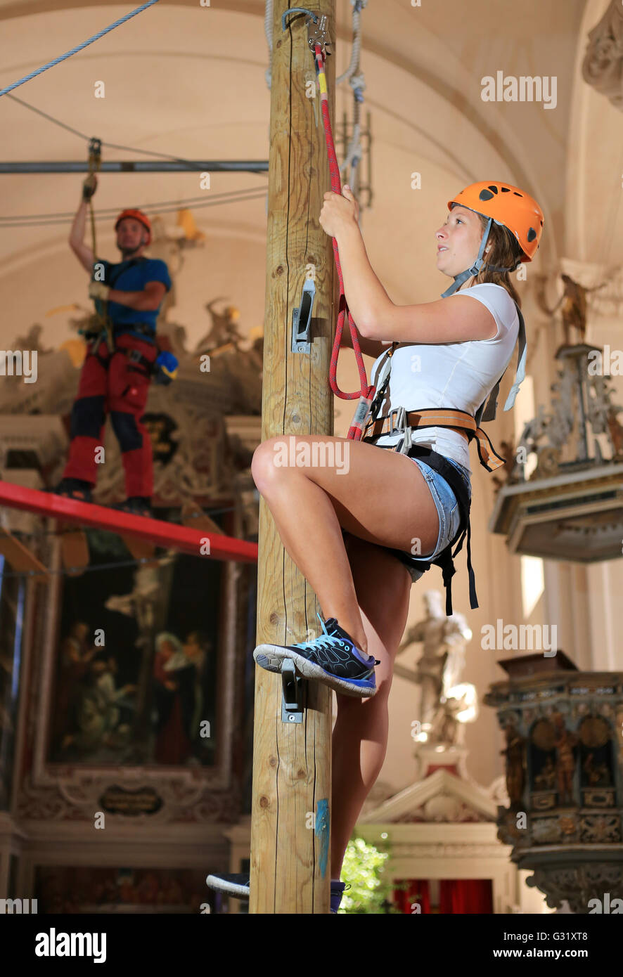 Theresa Rost is climbing in the church of St. Trinitatis in Zerbst, Germany, on 6 June 2016. The climbing project Stock Photo
