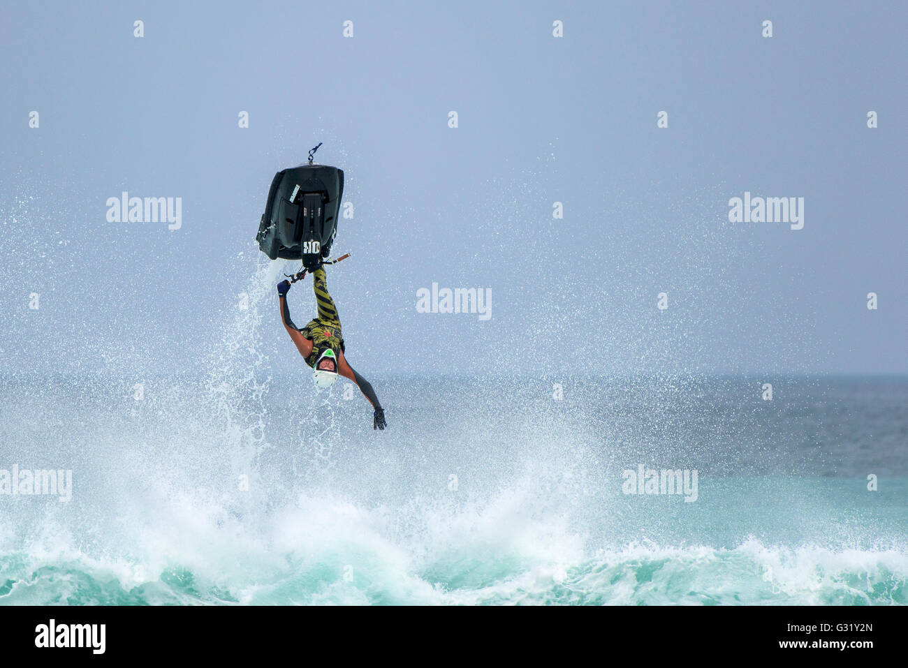 Fistral, Newquay, Cornwall. 6th June, 2016.  Dan Foy defies gravity as he performs a spectacular back flip on his - Stock Image