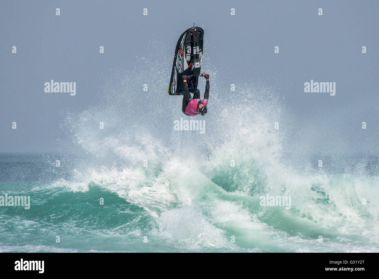 Fistral, Newquay, Cornwall. 6th June, 2016.  A Jet-skier explodes from the sea as he performs a spectacular stunt - Stock Image