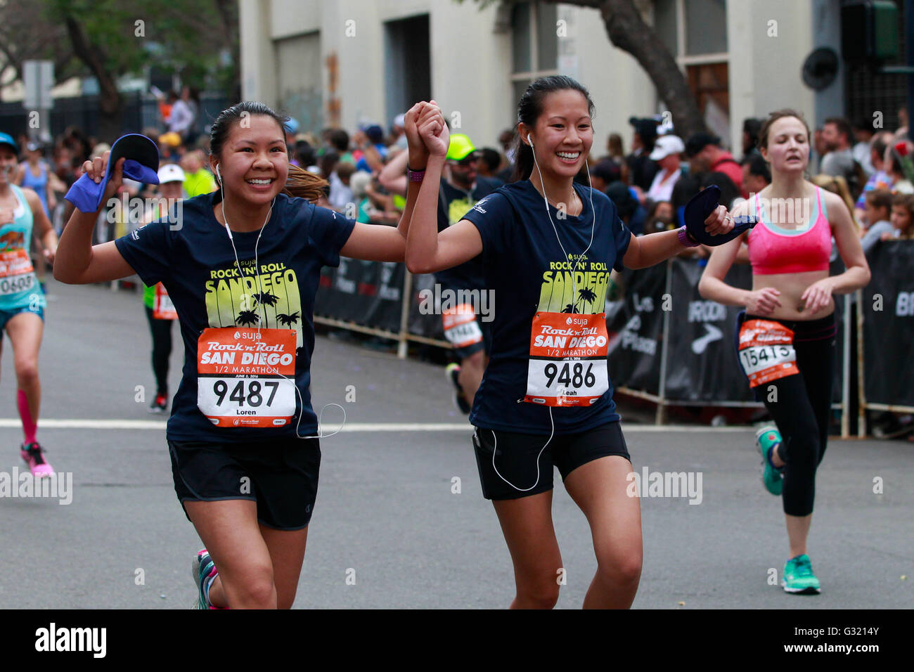 San Diego, California, USA. 5th June, 2016. SAN DIEGO CA, USA -- JUNE 2, 2016: .With the finish line in sight runners - Stock Image