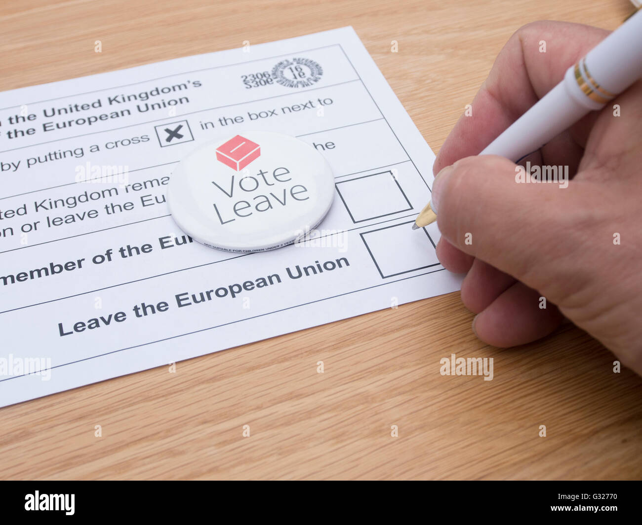 Exeter UK 7 June 2016 EU referendum voting by postal ballot with vote leave badge - Stock Image