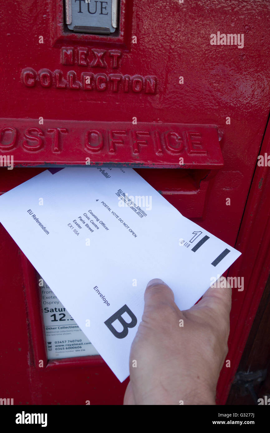 Exeter UK 7 June 2016 EU referendum voting by postal ballot posting vote into a post box. Last day to apply for - Stock Image