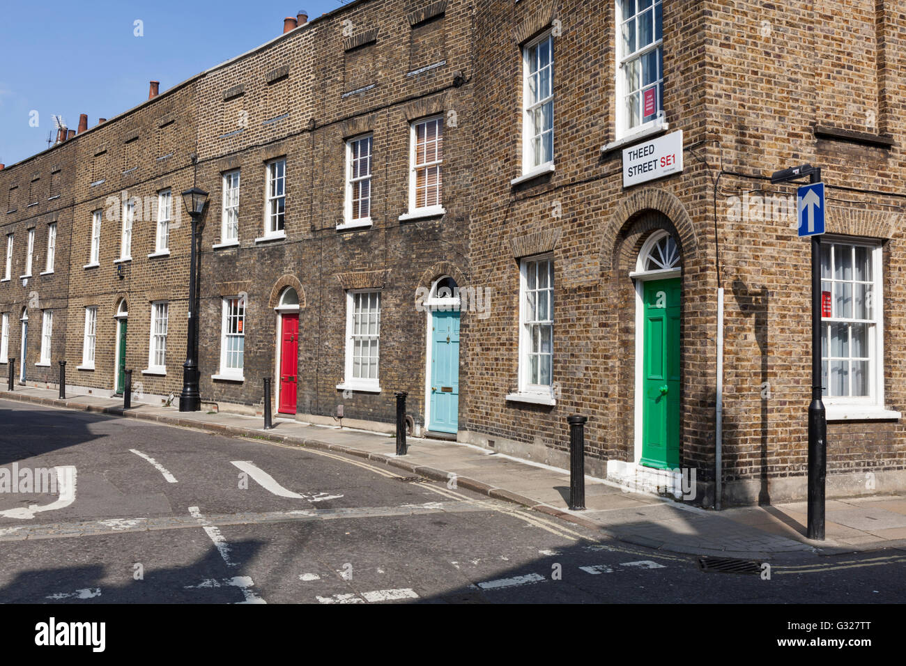 Traditional Victorian brick terraced houses on Theed Street in Lambeth, London, England. - Stock Image