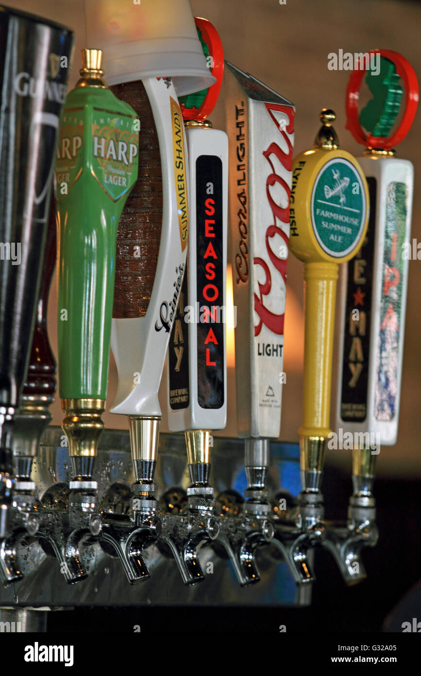 Beer taps at a bar in Cape May, New Jersey, USA - Stock Image