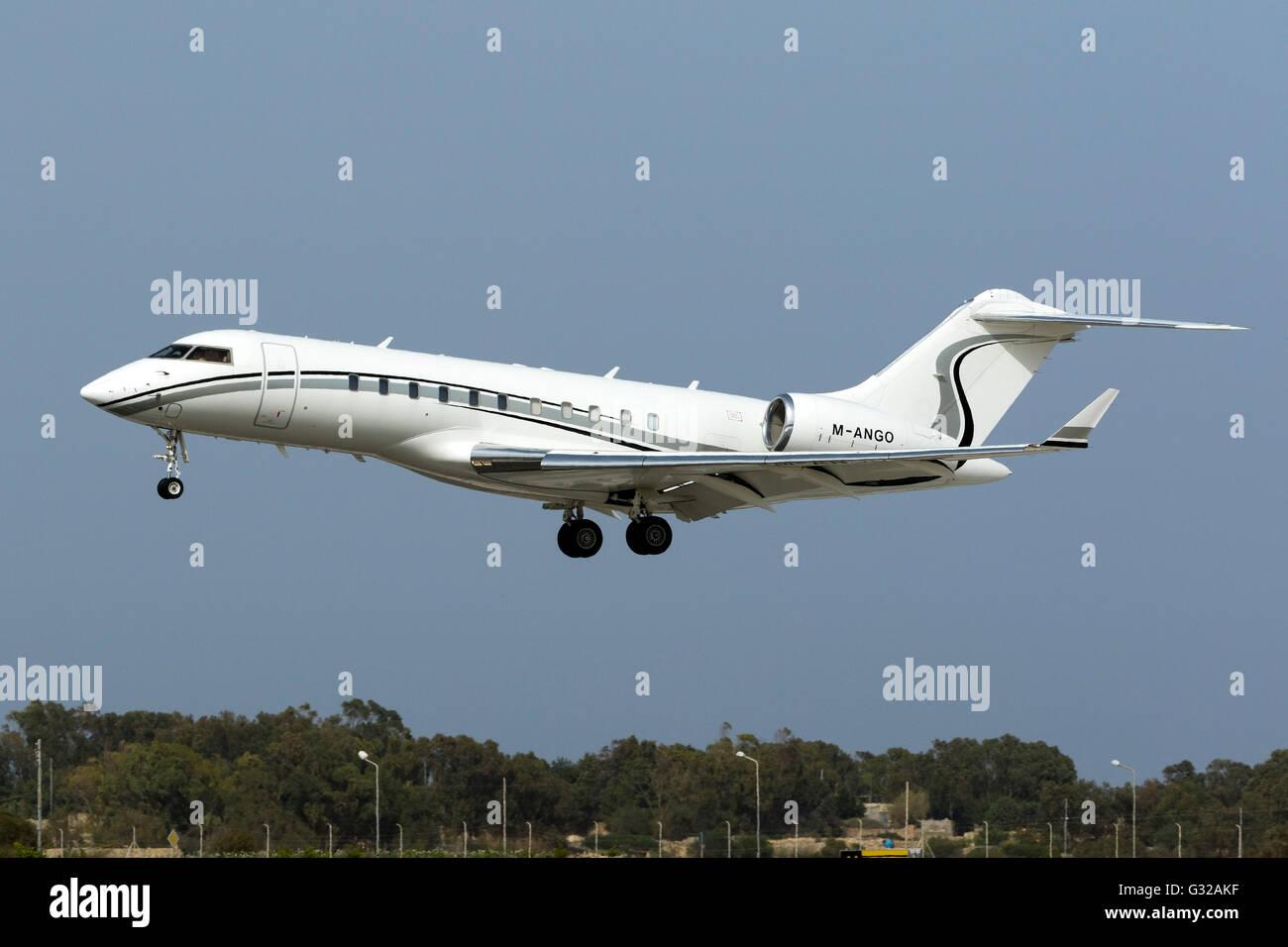 Bombardier Global 5000 (BD-700-1A11) [M-ANGO] landing runway 31. - Stock Image