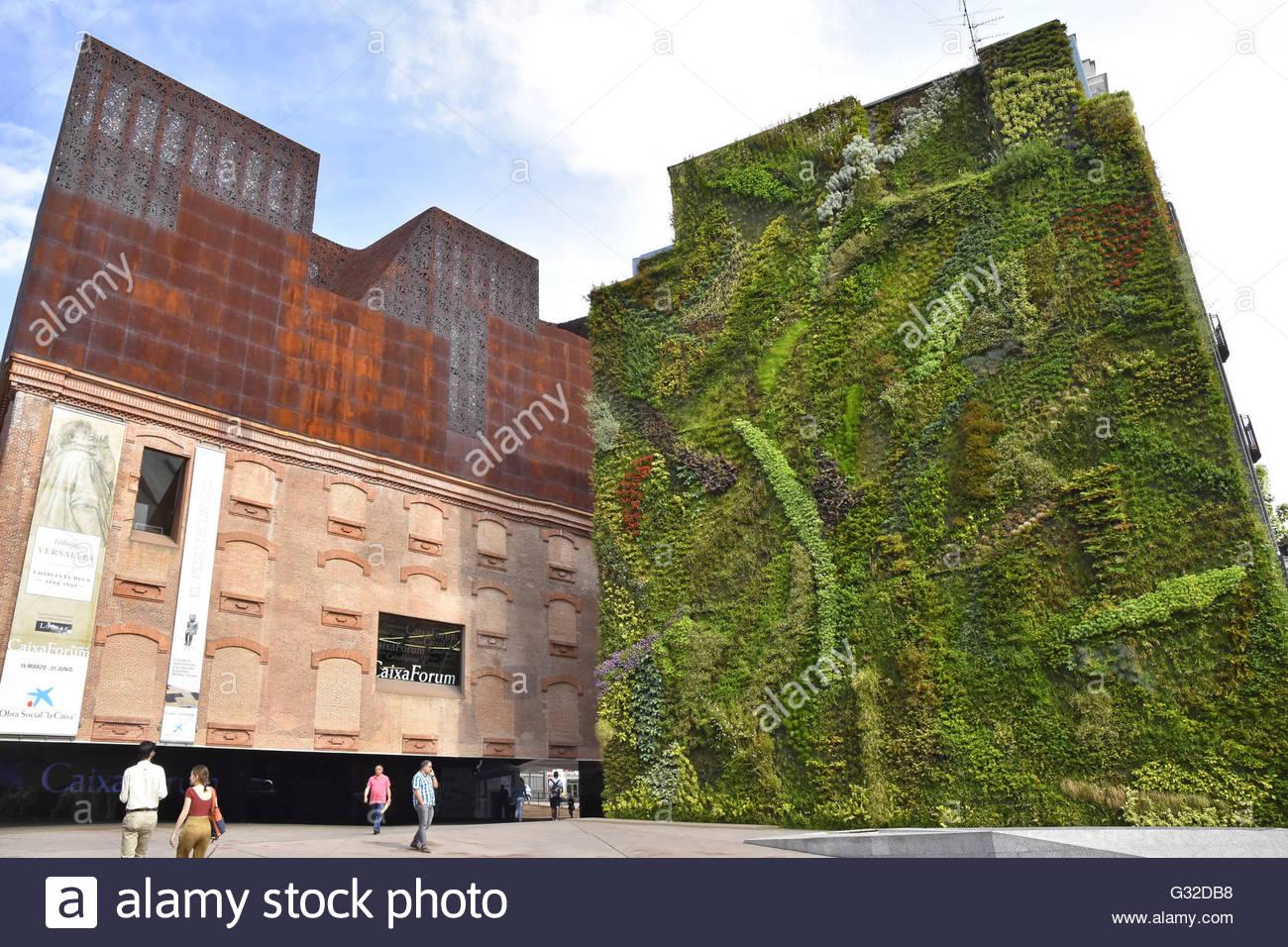 Green Vertical Garden House Facade Beside Caixaforum Museum And
