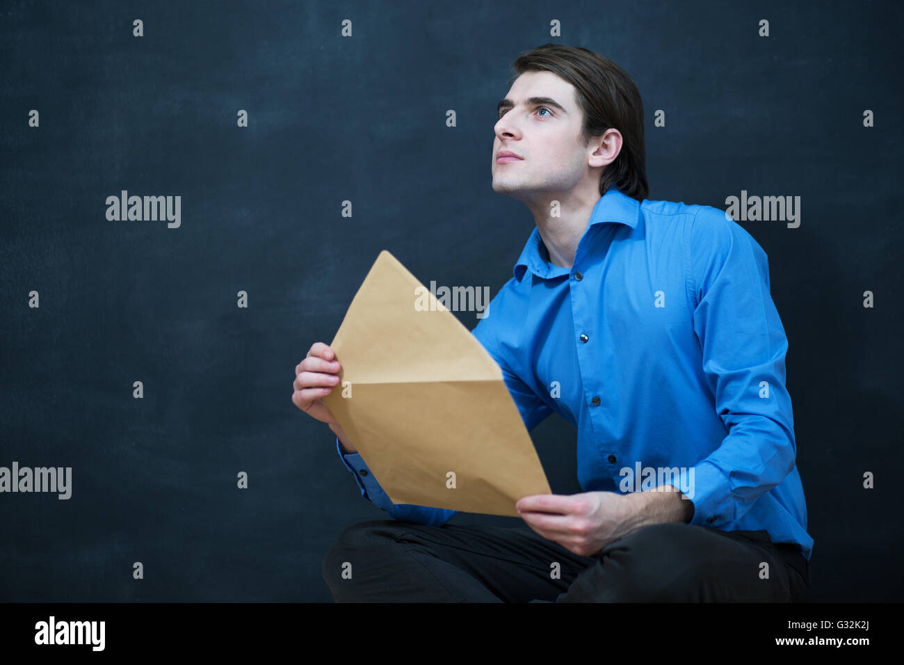 Businessman with letter,envelope - open Stock Photo