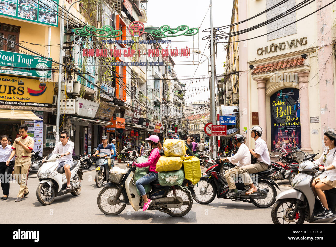 Busy motorbike traffic in the Old Quarter in Hanoi. Motorbikes have overtaken bicycles as the main form of transportation. - Stock Image
