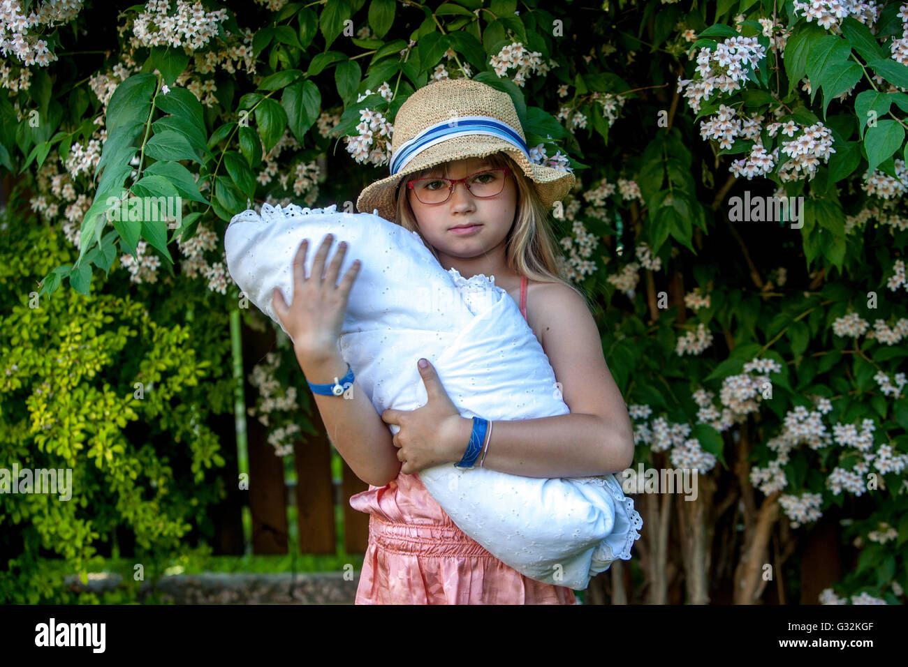 6- 7 year old girl with her doll - Stock Image