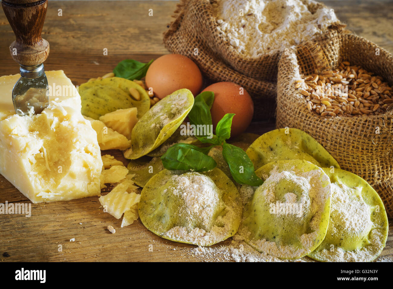 Dumplings / ravioli with cheese, basil and pine nuts, pesto. Pasta with integral flour. Stock Photo
