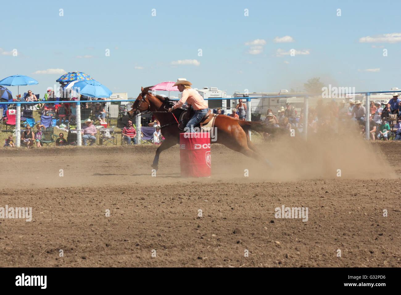 Barrel racing in a rodeo in Alberta, Canada - Stock Image