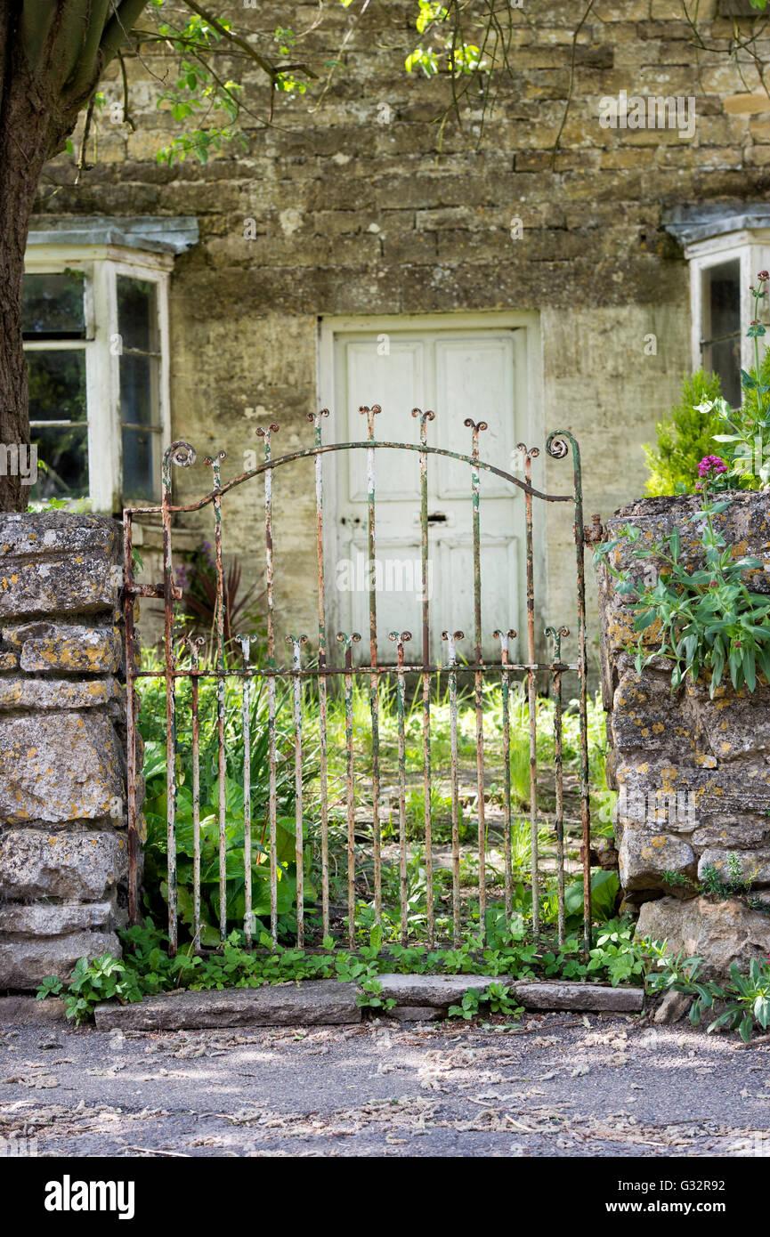 Old wrought iron cottage gate. Over Norton, Oxfordshire, England - Stock Image