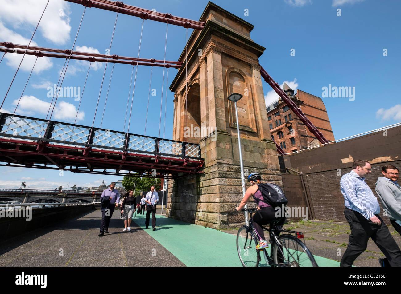 Cycleway and pedestrian walkway beneath Portland Street suspension bridge across the River Clyde in Glasgow, Scotland, - Stock Image