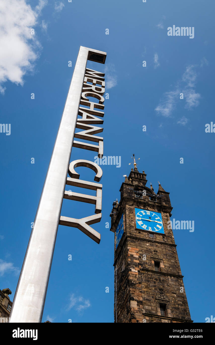 Merchant City sign and Tollbooth steeple or clock tower at Trongate in Glasgow, Scotland, united Kingdom - Stock Image