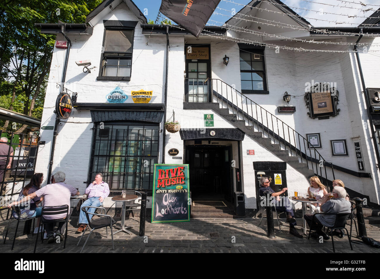 Exterior of Jinty Mcginty's pub on Ashton lane in west end of Glasgow, United Kingdom - Stock Image