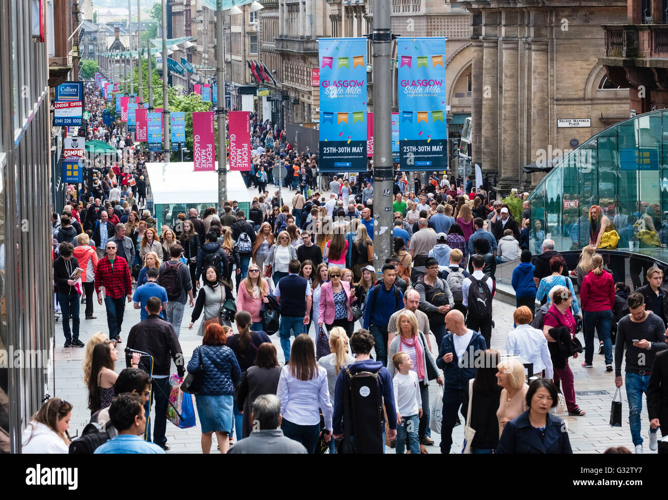 View of shoppers on busy Buchanan Street, popular shopping street,  in central Glasgow United Kingdom - Stock Image