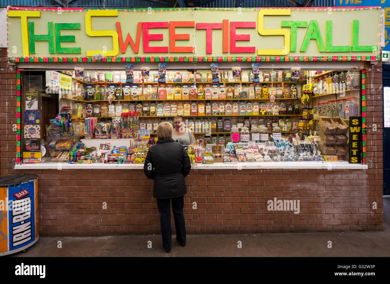 Sweet shop confectionary stall in barrow land Market , Gallowgate, Glasgow , United Kingdom - Stock Image