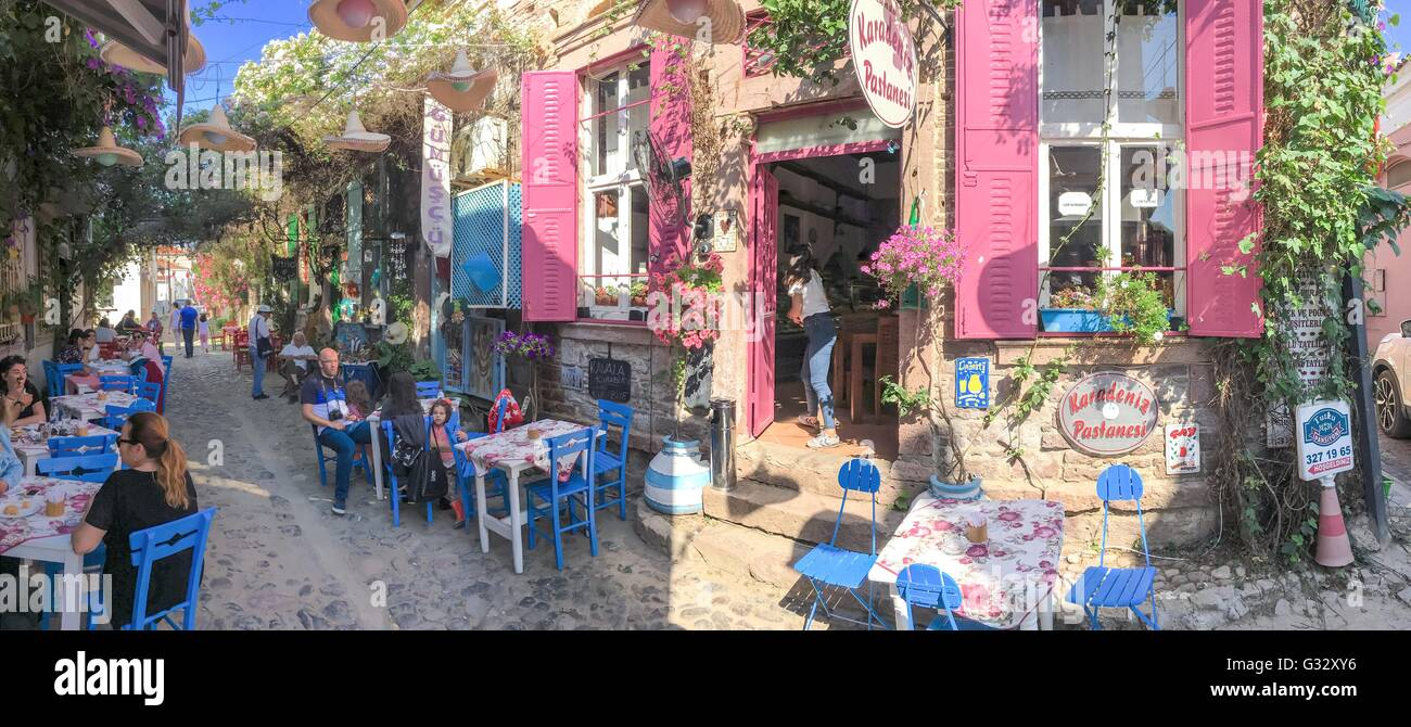 open street cafe in old touristic town Cunda Alibey Island, Ayvalik.It is a small island in the northwestern Aegean - Stock Image