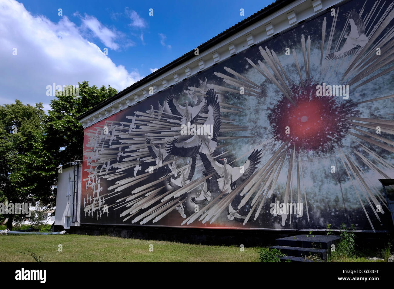 Exterior mural of a museum commemorating the Chernobyl nuclear disaster depicting  an exploding reactor core and - Stock Image