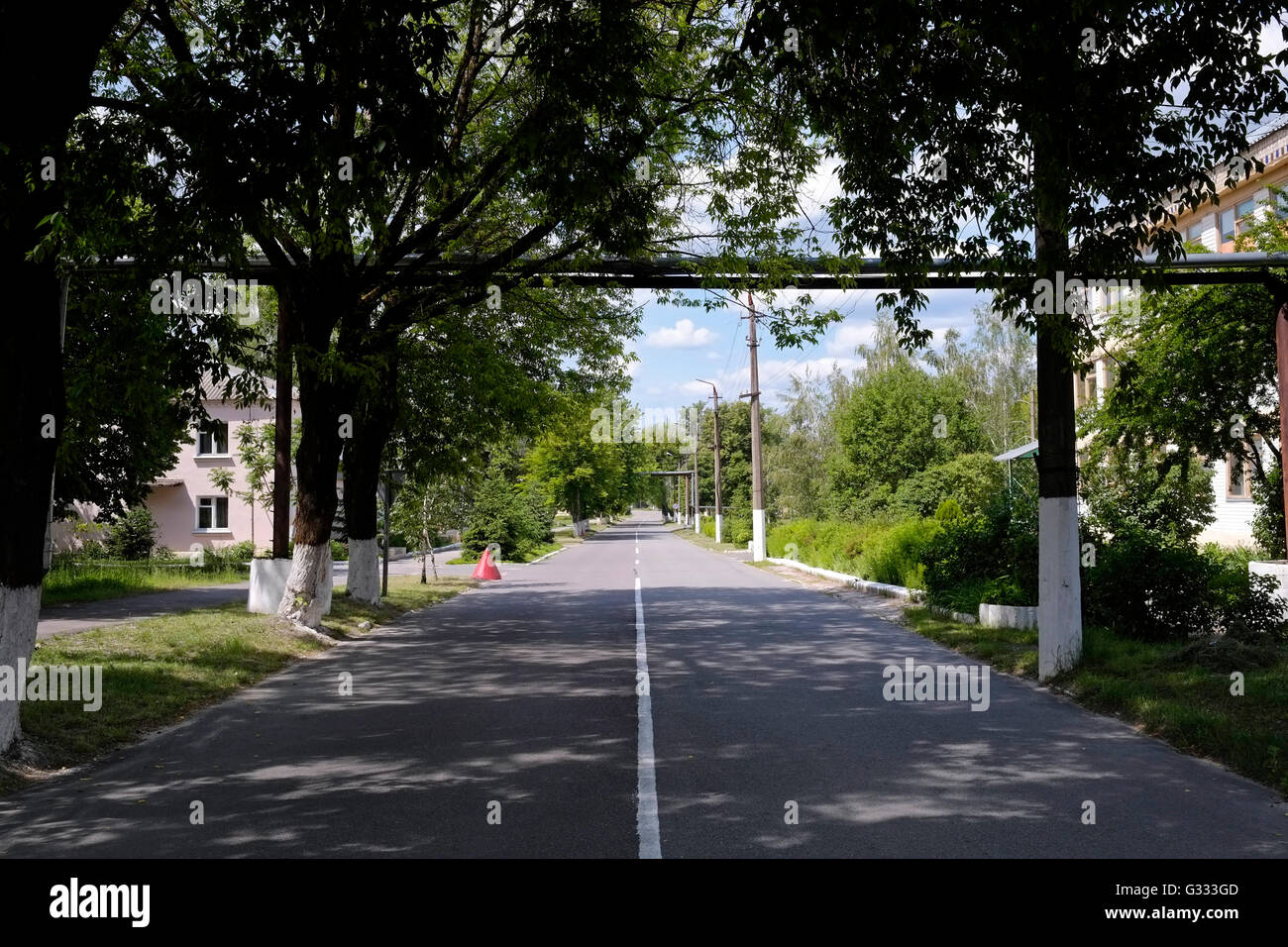 Empty road in the town of Chetnobyl located inside the Chernobyl Exclusion Zone in Ukraine on 04 June 2016. The - Stock Image