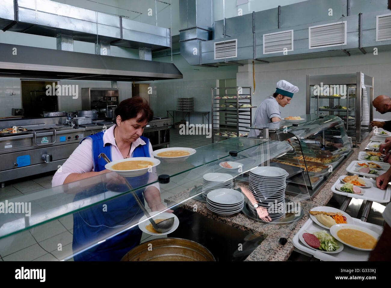Ukrainian kitchen workers serving food at the canteen of Chernobyl nuclear site in Ukraine on 04 June 2016. The - Stock Image