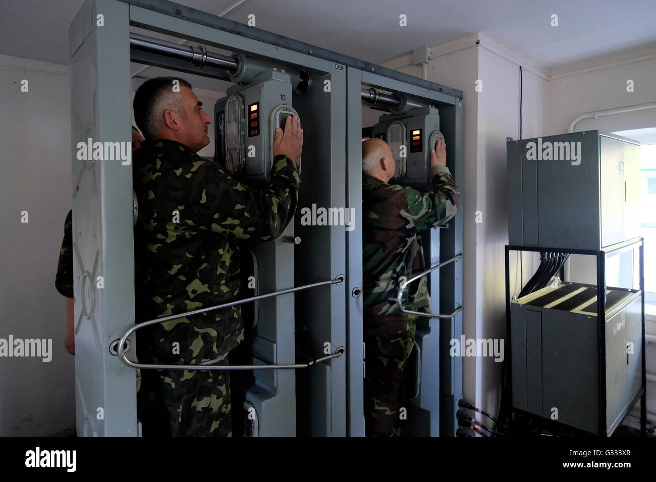 Ukrainian soldiers undergo a radiation control after they leave the contaminated area at the Chernobyl nuclear site - Stock Image