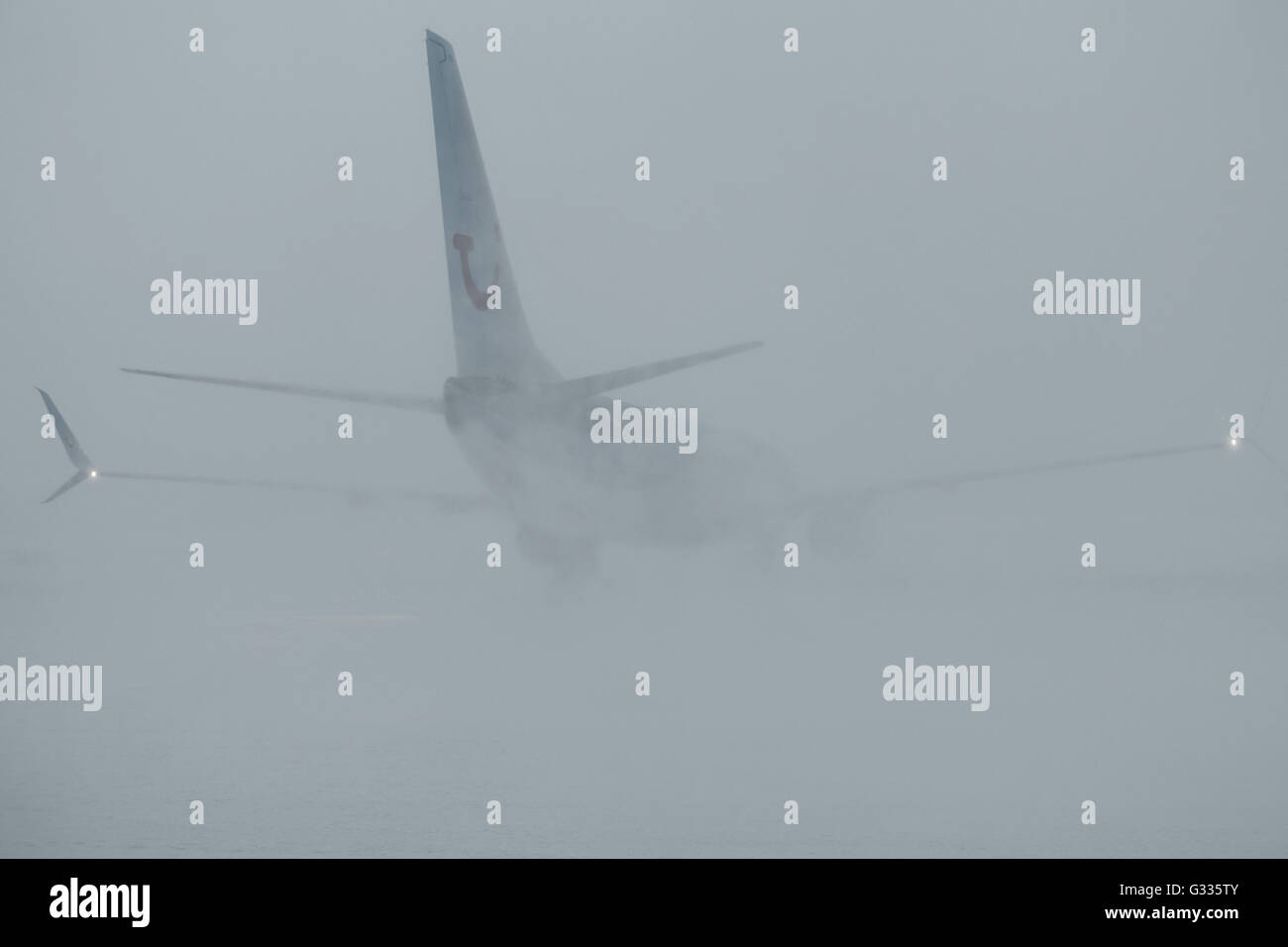 Kittilae, Finland, aircraft swirls on startup snow from the runway Stock Photo
